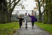 25 November 2019; The achievements of 15 young people from Just Ask Homework Club were recognised last Saturday the 23rd of November at Fairview parkrun as part of the Vhi Run For Fun programme. The 8-week course is supported by the Irish Youth Foundation and encourages young people from disadvantaged communities to embrace the benefits offered through running, culminating with a 5km parkrun. Youth leaders across Ireland are invited to apply for Run for Fun 2020 at https://iyf.ie/vhirunforfun/ before 6th December 2019 at 6pm. Pictured are Bradley Towell and Callum Walker of Just Ask Homework Club, and Brighid Smyth, Head of Corporate Communications, Vhi, as they come home to finish the Fairview parkrun, at Fairview Park, Dublin. Photo by Seb Daly/Sportsfile