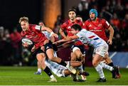 23 November 2019; Mike Haley of Munster is tackled by Teddy Iribaren of Racing 92 during the Heineken Champions Cup Pool 4 Round 2 match between Munster and Racing 92 at Thomond Park in Limerick. Photo by Brendan Moran/Sportsfile