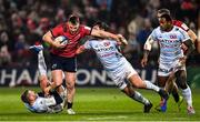 23 November 2019; Rory Scannell of Munster is tackled by Finn Russell and Henry Chavancy of Racing 92 during the Heineken Champions Cup Pool 4 Round 2 match between Munster and Racing 92 at Thomond Park in Limerick. Photo by Brendan Moran/Sportsfile