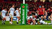 23 November 2019; JJ Hanrahan of Munster  loses possession as he is tackled by Simon Zebo of Racing 92 during the Heineken Champions Cup Pool 4 Round 2 match between Munster and Racing 92 at Thomond Park in Limerick. Photo by Brendan Moran/Sportsfile
