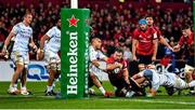 23 November 2019; JJ Hanrahan of Munster loses possession as he is tackled by Simon Zebo of Racing 92 short of the try line during the Heineken Champions Cup Pool 4 Round 2 match between Munster and Racing 92 at Thomond Park in Limerick. Photo by Brendan Moran/Sportsfile
