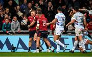 23 November 2019; Andrew Conway of Munster celebrates with team-mates Mike Haley and Alby Mathewson after scoring his side's second try despite the efforts of Brice Dulin of Racing 92 during the Heineken Champions Cup Pool 4 Round 2 match between Munster and Racing 92 at Thomond Park in Limerick. Photo by Diarmuid Greene/Sportsfile