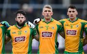 24 November 2019; Corofin players, from left, Conor Cunningham, Kieran Fitzgerald, and Ronan Steede stand for Amhrán na bhFiann before the AIB Connacht GAA Football Senior Club Football Championship Final match between Corofin and Pádraig Pearses at Tuam Stadium in Tuam, Galway. Photo by Piaras Ó Mídheach/Sportsfile