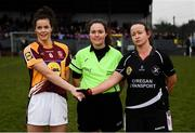 24 November 2019; Marie Larkin of MacHale Rovers and Eileen Lyons of Donoughmore shake hands across Referee Siobhan Coyle prior to the All-Ireland Ladies Junior Club Championship Final match between Donoughmore and MacHale Rovers at Duggan Park in Ballinasloe, Co Galway. Photo by Harry Murphy/Sportsfile
