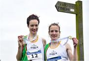 24 November 2019; Fionnuala McCormack, right, with her sister Una Britton, both of Kilcoole A.C., Co. Wicklow, after winning gold and bronze medals in the Senior Women event during the Irish Life Health National Senior, Junior & Juvenile Even Age Cross Country Championships at the National Sports Campus Abbotstown in Dublin. Photo by Sam Barnes/Sportsfile