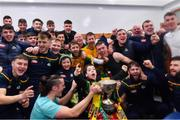24 November 2019; Corofin supporter Tomás McLoughlin, age 9, celebrates with the players in the dressing room after the AIB Connacht GAA Football Senior Club Football Championship Final match between Corofin and Pádraig Pearses at Tuam Stadium in Tuam, Galway. Photo by Piaras Ó Mídheach/Sportsfile