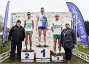 24 November 2019; Senior Men's medallists, from left, Brian Fay of Raheny Shamrock A.C., Co. Dublin, silver, Liam Brady of Tullamore Harriers A.C., Co. Offaly, gold, and Sean Tobin of Clonmel AC, Co. Tipperary, bronze, alongside John Cronin, Chair of Competitions, and Athletics Ireland President Georgina Drumm, during the Irish Life Health National Senior, Junior & Juvenile Even Age Cross Country Championships at the National Sports Campus Abbotstown in Dublin. Photo by Sam Barnes/Sportsfile