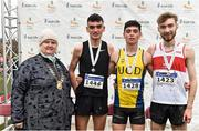 24 November 2019; Athletics Ireland president Georgina Drumm with Junior Men's medallists, from left, Keelan Kilrehill of Moy Valley A.C., Co. Antrim, silver, Darragh McElhinney of U.C.D. A.C., Co. Dublin, gold, and Thomas Mc Stay of Galway City Harriers A.C., Co. Galway, bronze, during the Irish Life Health National Senior, Junior & Juvenile Even Age Cross Country Championships at the National Sports Campus Abbotstown in Dublin. Photo by Sam Barnes/Sportsfile