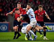 23 November 2019; Chris Farrell of Munster is tackled by Finn Russell of Racing 92 during the Heineken Champions Cup Pool 4 Round 2 match between Munster and Racing 92 at Thomond Park in Limerick. Photo by Brendan Moran/Sportsfile