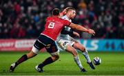 23 November 2019; Finn Russell of Racing 92 kicks past CJ Stander of Munster during the Heineken Champions Cup Pool 4 Round 2 match between Munster and Racing 92 at Thomond Park in Limerick. Photo by Brendan Moran/Sportsfile