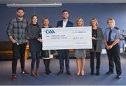 29 November 2019; GAA representative Kevin Sexton, left, and member of An Garda Síochána Jen Keegan, right, present a cheque to, from left, Deidre Walsh of Western Alzheimers, Liz Yates of the Marie Keating Foundation, Donal Kitt of Enable Ireland and Ciara Carty and Elaine Fleming of Focus Ireland during the GAA Charities Cheque Handover at Canal Café in Croke Park, Dublin. Photo by Harry Murphy/Sportsfile