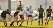 29 November 2019; Antrim's Neil McManus of 2019 PwC All-Star in action against Clare's John Conlon of 2018 PwC All-Star and Donegal's Declan Coulter of 2018 PwC All-Star  during the PwC All Star Hurling Tour 2019 All Star game at Zayed Sport City in Abu Dhabi, United Arab Emirates. Photo by Ray McManus/Sportsfile
