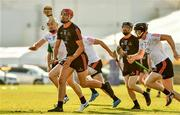 29 November 2019; Clare's Peter Duggan of 2018 PwC All-Star  in action against Tipperary's Pádraic Maher of 2019 PwC All-Star during the PwC All Star Hurling Tour 2019 All Star game at Zayed Sport City in Abu Dhabi, United Arab Emirates. Photo by Ray McManus/Sportsfile