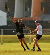 29 November 2019; Tipperary's John McGrath of 2019 PwC All-Star in action against Limerick's Dan Morrissey of 2018 PwC All-Star during the PwC All Star Hurling Tour 2019 All Star game at Zayed Sport City in Abu Dhabi, United Arab Emirates. Photo by Ray McManus/Sportsfile