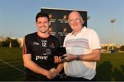 29 November 2019; Donegal's Declan Coulter of 2018 PwC All-Star is made a presentation to by Uachtaráin Cumann Lúthchleas Gael John Horan after the PwC All Star Hurling Tour 2019 All Star game at Zayed Sport City in Abu Dhabi, United Arab Emirates.Uachtaráin Cumann Lúthchleas Gael John Horan Photo by Ray McManus/Sportsfile
