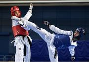 29 November 2019; Patrycja Adamkiewicz of Poland, right, in action against Elena Evlampyeva of Russia during the Taekwondo Europe Olympic Weight Categories Championships at the National Indoor Arena in Abbotstown, Dublin. Photo by Harry Murphy/Sportsfile