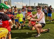 29 November 2019; Donegal's Declan Coulter of 2018 PwC All-Star teamwith local children during a coaching session before the PwC All Star Hurling Tour 2019 All Star game at Zayed Sport City in Abu Dhabi, United Arab Emirates. Photo by Ray McManus/Sportsfile