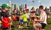 29 November 2019; Donegal's Declan Coulter of 2018 PwC All-Star team with local children during a coaching session before the PwC All Star Hurling Tour 2019 All Star game at Zayed Sport City in Abu Dhabi, United Arab Emirates. Photo by Ray McManus/Sportsfile