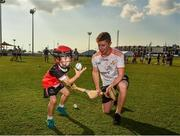 29 November 2019; Sligo's James Weir of 2019 PwC All-Star team with seven year old Daithi Walsh during a coaching session before the PwC All Star Hurling Tour 2019 All Star game at Zayed Sport City in Abu Dhabi, United Arab Emirates. Photo by Ray McManus/Sportsfile