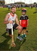 29 November 2019; Antrim's Neil McManus of 2019 PwC All-Star with seven year old Daithi Walsh during a coaching session before the PwC All Star Hurling Tour 2019 All Star game at Zayed Sport City in Abu Dhabi, United Arab Emirates. Photo by Ray McManus/Sportsfile