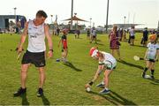 29 November 2019; Clare's John Conlon of 2018 PwC All-Star team with local child Eliana Brennan, seven years, during a coaching session before the PwC All Star Hurling Tour 2019 All Star game at Zayed Sport City in Abu Dhabi, United Arab Emirates. Photo by Ray McManus/Sportsfile