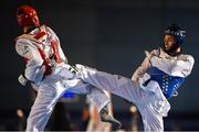 29 November 2019; Konstantin Minin of Russia, right, in action against Nimrod Krivishkiy of Israel during the Taekwondo Europe Olympic Weight Categories Championships at the National Indoor Arena in Abbotstown, Dublin. Photo by Harry Murphy/Sportsfile