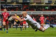 29 November 2019; Matt Faddes of Ulster dives over to score his side's first try during the Guinness PRO14 Round 7 match between Ulster and Scarlets at the Kingspan Stadium in Belfast. Photo by Ramsey Cardy/Sportsfile