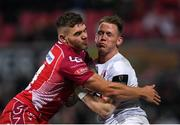 29 November 2019; Craig Gilroy of Ulster is tackled by Corey Baldwin of Scarlets during the Guinness PRO14 Round 7 match between Ulster and Scarlets at the Kingspan Stadium in Belfast. Photo by Ramsey Cardy/Sportsfile