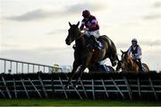 30 November 2019; Conflated, with Jack Kennedy up, jumps the last on their way to winning the Kettles Country House Supporting Fingal Ravens GAA Maiden Hurdle on Day One of the Fairyhouse Winter Festival at Fairyhouse Racecourse in Ratoath, Meath. Photo by Harry Murphy/Sportsfile