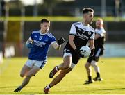 11 December 2019; Ryan Johnston of Kilcoo in action against Eunan Doherty of Naomh Conaill during the AIB Ulster GAA Football Senior Club Championship Final match between Kilcoo and Naomh Conaill at Healy Park in Omagh, Tyrone. Photo by Oliver McVeigh/Sportsfile