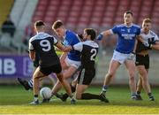 1 December 2019; Dylan Ward and Niall Brannigan of Kilcoo attempting to block Charles McGuinness of Naomh Conaill during the AIB Ulster GAA Football Senior Club Championship Final match between Kilcoo and Naomh Conaill at Healy Park in Omagh, Tyrone. Photo by Oliver McVeigh/Sportsfile