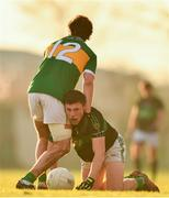 1 December 2019; Mark Cronin of Nemo Rangers is tackled by Ross Peters of Clonmel Commercials during the AIB Munster GAA Football Senior Club Championship Final match between Nemo Rangers and Clonmel Commercials at Fraher Field in Dungarvan, Waterford. Photo by Eóin Noonan/Sportsfile