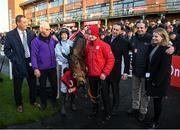 1 December 2019; Trainer Gordon Eliott, representative owner Kenneth Alexander, jockey Rachael Blackmore with Honeysuckle and winning connections after winning the BARONERACING.COM Hatton's Grace Hurdle on Day 2 of the Fairyhouse Winter Festival at Fairyhouse Racecourse in Meath. Photo by Harry Murphy/Sportsfile