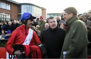 1 December 2019; Jockey Davy Russell, left, speaks with trainer Gordon Elliott and representative owner Chris Hitchens after sending out Evoi Allen to win the BARONERACING.COM Royal Bond Novice Hurdle on Day 2 of the Fairyhouse Winter Festival at Fairyhouse Racecourse in Meath. Photo by Harry Murphy/Sportsfile