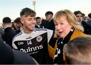 1 December 2019; Jerome Johnston of Kilcoo celebrates with a fan after the AIB Ulster GAA Football Senior Club Championship Final match between Kilcoo and Naomh Conaill at Healy Park in Omagh, Tyrone. Photo by Oliver McVeigh/Sportsfile