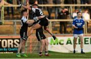 1 December 2019; Justin Clarke, Paul Devlin and Aaron Morgan of Kilcoo celebrate after the AIB Ulster GAA Football Senior Club Championship Final match between Kilcoo and Naomh Conaill at Healy Park in Omagh, Tyrone. Photo by Oliver McVeigh/Sportsfile