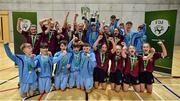5 December 2019; The winning boys team Rice College, Westport, Co Mayo and the winning girls team Presentation Secondary School, Thurles, Co Tipperary, celebrate together following the FAI Post Primary Schools Futsal National Finals in the WIT Arena, Waterford United. Photo by David Fitzgerald/Sportsfile