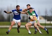 7 December 2019; Jordan Hayes of Offaly in action against Jason Moore, left, and Diarmuid Whelan of Laois during the 2020 O'Byrne Cup Round 1 match between Laois and Offaly at McCann Park in Portarlington, Co Laois. Photo by Harry Murphy/Sportsfile
