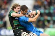 7 December 2019; Ross Byrne of Leinster is tackled by Jamie Gibson of Northampton Saints during the Heineken Champions Cup Pool 1 Round 3 match between Northampton Saints and Leinster at Franklins Gardens in Northampton, England. Photo by Ramsey Cardy/Sportsfile