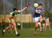 7 December 2019; Evan O'Carroll of Laois in action against Cian Donohoe of Offaly during the 2020 O'Byrne Cup Round 1 match between Laois and Offaly at McCann Park in Portarlington, Co Laois. Photo by Harry Murphy/Sportsfile