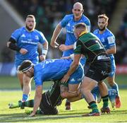 7 December 2019; Caelan Doris of Leinster is tackled by Matt Proctor, left, and Alex Waller of Northampton Saints during the Heineken Champions Cup Pool 1 Round 3 match between Northampton Saints and Leinster at Franklins Gardens in Northampton, England. Photo by Ramsey Cardy/Sportsfile