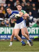 7 December 2019; Eoin Buggie of Laois in action against Cian Johnson of Offaly during the 2020 O'Byrne Cup Round 1 match between Laois and Offaly at McCann Park in Portarlington, Co Laois. Photo by Harry Murphy/Sportsfile