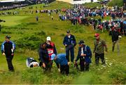 18 July 2019; Rory McIlroy of Northern Ireland tries to find his ball on the 1st hole during Day One of the 148th Open Championship at Royal Portrush in Portrush, Co Antrim. Photo by Ramsey Cardy/Sportsfile