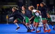 3 November 2019; Ireland players, from left, Nicola Daly, Roisin Upton, Bethany Barr, Chloe Watkins and Gillian Pinder celebrate winning the penalty strokes and qualifying for the Tokyo2020 Olympic Games during the FIH Women's Olympic Qualifier match between Ireland and Canada at Energia Park in Dublin. Photo by Brendan Moran/Sportsfile