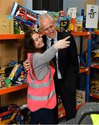 8 December 2019; Republic of Ireland manager Mick McCarthy was on hand today to hand over Republic of Ireland bags filled with jerseys, footballs, scarfs & other merchandise to St Vincent De Paul staff, at the St Vincent De Paul depot on Sean McDermott Street, Summerhill, Dublin. The gifts are part of an annual Christmas donation for families in need. Pictured are Republic of Ireland manager Mick McCarthy and Lauren Buckley, Corporate Volunteer from Electric Ireland, at the St Vincent De Paul depot on Sean McDermott Street, Summerhill, Dublin. Photo by Seb Daly/Sportsfile