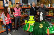 8 December 2019; Republic of Ireland manager Mick McCarthy was on hand today to hand over Republic of Ireland bags filled with jerseys, footballs, scarfs & other merchandise to Liam Casey, East Region President, St Vincent De Paul, at the St Vincent De Paul depot on Sean McDermott Street, Summerhill, Dublin. The gifts are part of an annual Christmas donation for families in need. Pictured are Republic of Ireland manager Mick McCarthy, Liam Casey, East Region President, St Vincent De Paul, and corporate volunteers from Electric Ireland, at the St Vincent De Paul depot on Sean McDermott Street, Summerhill, Dublin. Photo by Seb Daly/Sportsfile