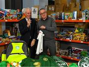 8 December 2019; Republic of Ireland manager Mick McCarthy was on hand today to hand over Republic of Ireland bags filled with jerseys, footballs, scarfs & other merchandise to Liam Casey, East Region President, St Vincent De Paul, at the St Vincent De Paul depot on Sean McDermott Street, Summerhill, Dublin. The gifts are part of an annual Christmas donation for families in need. Photo by Seb Daly/Sportsfile