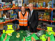 8 December 2019; Republic of Ireland manager Mick McCarthy was on hand today to hand over Republic of Ireland bags filled with jerseys, footballs, scarfs & other merchandise to St Vincent De Paul staff, at the St Vincent De Paul depot on Sean McDermott Street, Summerhill, Dublin. The gifts are part of an annual Christmas donation for families in need. Pictured are Republic of Ireland manager Mick McCarthy, right, and Christmas Project Worker Colm Kelly, at the St Vincent De Paul depot on Sean McDermott Street, Summerhill, Dublin. Photo by Seb Daly/Sportsfile