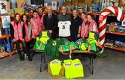8 December 2019; Republic of Ireland manager Mick McCarthy was on hand today to hand over Republic of Ireland bags filled with jerseys, footballs, scarfs & other merchandise to Liam Casey, centre, East Region President, St Vincent De Paul, at the St Vincent De Paul depot on Sean McDermott Street, Summerhill, Dublin. The gifts are part of an annual Christmas donation for families in need. Pictured are Republic of Ireland manager Mick McCarthy, Liam Casey, East Region President, St Vincent De Paul, and corporate volunteers from Electric Ireland, at the St Vincent De Paul depot on Sean McDermott Street, Summerhill, Dublin. Photo by Seb Daly/Sportsfile
