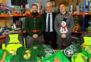 8 December 2019; Republic of Ireland manager Mick McCarthy was on hand today to hand over Republic of Ireland bags filled with jerseys, footballs, scarfs & other merchandise to St Vincent De Paul staff, at the St Vincent De Paul depot on Sean McDermott Street, Summerhill, Dublin. The gifts are part of an annual Christmas donation for families in need. Pictured are Republic of Ireland manager Mick McCarthy, centre, and Corporate Volunteers from Electric Ireland Joe Scully, left, and Emmet Higgins, at the St Vincent De Paul depot on Sean McDermott Street, Summerhill, Dublin. Photo by Seb Daly/Sportsfile